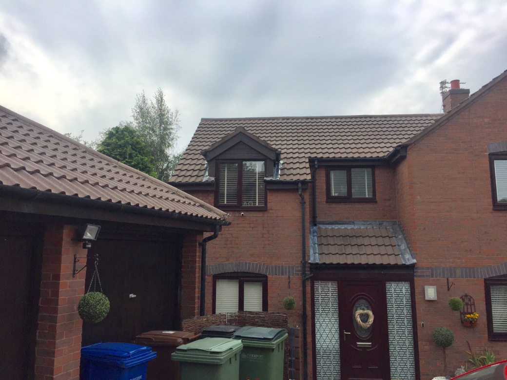 Roof cleaning in Stockport and Wilmslow.